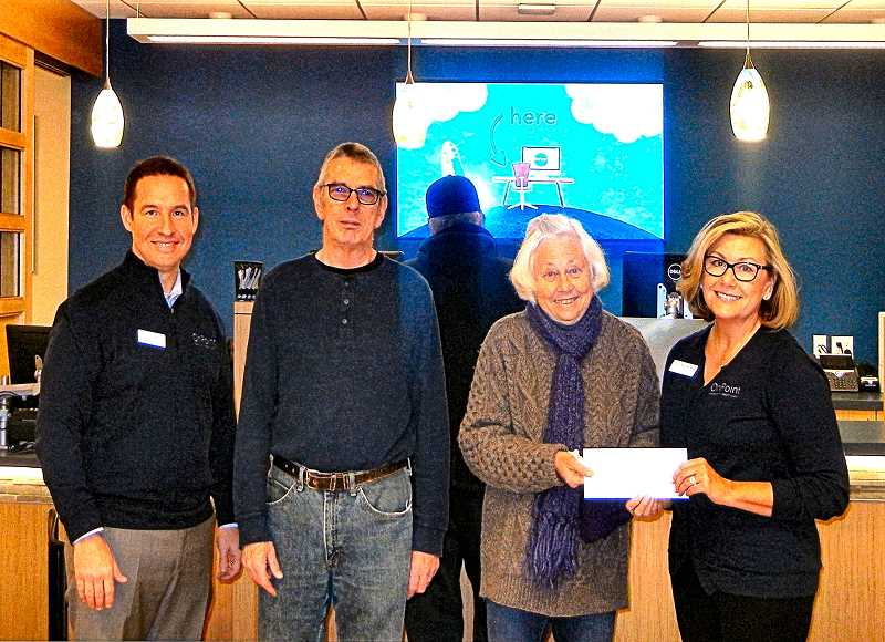ELIZABETH USSHER GROFF - OnPoint Credit Union presents a check to the Friends of the Woodstock Community Center at its December Grand Opening in Safeway. From left: Stephen Owen, OnPoint Chief Operations Officer; Pete Adams and Terry Griffiths of the FWCC; AND Kelli Summerfield, OnPoint Branch Manager.