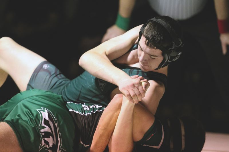PAMPLIN MEDIA GROUP: PHILLIP HAWKINS - Estacadas Lance Moser works out of the top position on his way to an 8-0 major decision last week against North Marion.