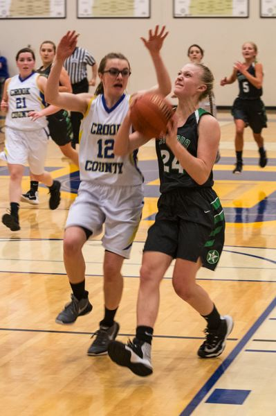PAMPLIN MEDIA GROUP: LON AUSTIN - Estacadas Isabelle Hagel drives to the basket on a fastbreak during the Rangers 49-37 road win at Crook County to start league play last week.