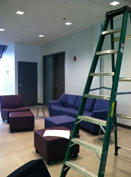 OUTLOOK PHOTO: TERESA CARSON - The Youth Opportunity Center of New Avenues for Youth will open this spring, but some comfy furniture has already been delivered. It shares the stunning, modern Stark Street campus with Open School East and the Boys & Girls Club.