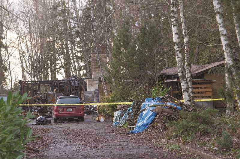 INDEPENDENT PHOTO: JULIA COMNES - Woodstove embers flew into the attic of this house, setting it on fire and killing its sole occupant in the early morning hours of Dec. 29.