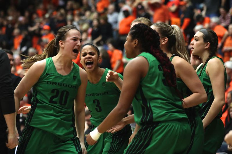TRIBUNE PHOTO: JAIME VALDEZ - Sabrina Ionescu (left) and Oregon teammates celebrate after her 3-pointer sent Friday's game to overtime at Corvallis. Oregon State won, but the Ducks got revenge with a Sunday romp in Eugene.