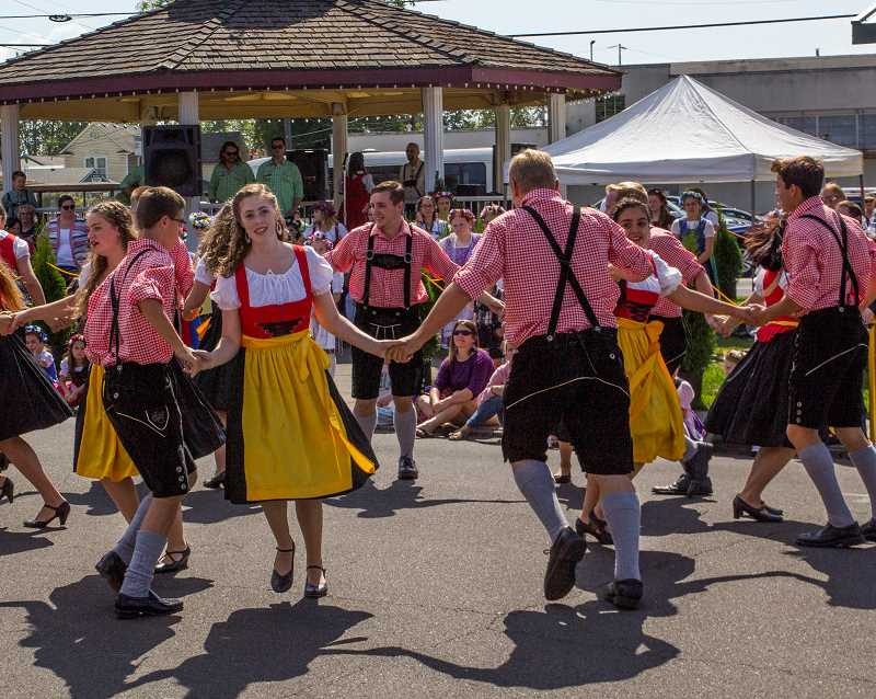 INDEPENDENT FILE PHOTO - Youths dance in front of the downtown gazebo at the Mount Angel Oktoberfest in September 2017. The event allowed the Oktoberfest board to donate more than $103,000 to local charities.