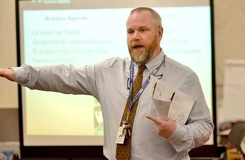 SPOKESMAN PHOTO: VERN UYETAKE  - Lowrie Primary principal Patrick Meigs explains the dual language program to those in attendance at last week's meeting.