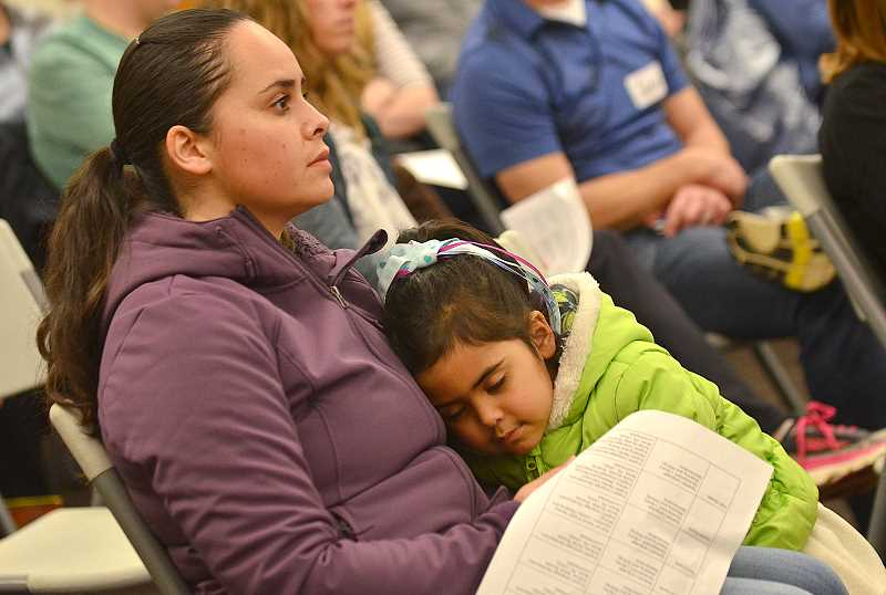 SPOKESMAN PHOTO: VERN UYETAKE - Jenny Bravo listens closely to the presentation with her daughter Hannan.