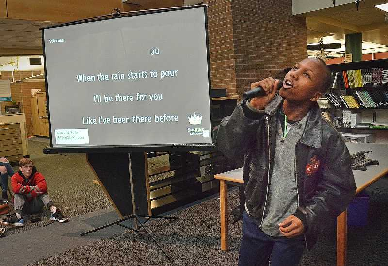 TIDINGS PHOTO: VERN UYETAKE  - Emmett Black engages the audience with 'I'll be there for you.'