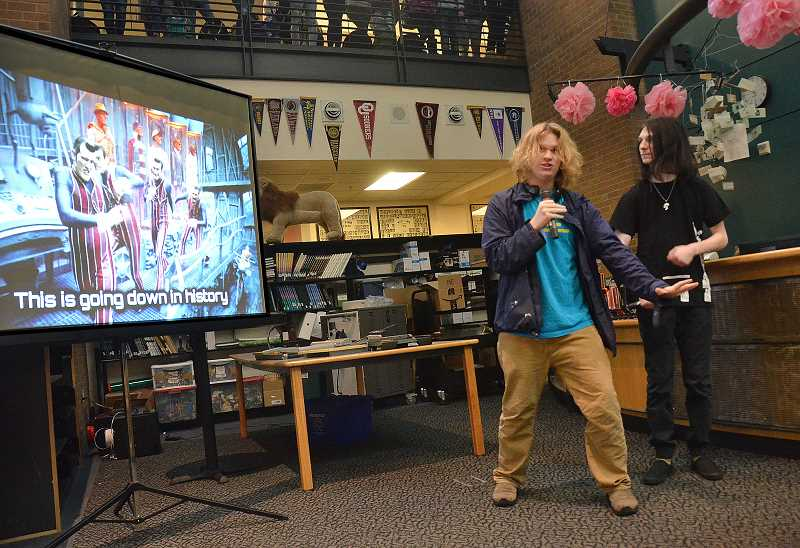 TIDINGS PHOTO: VERN UYETAKE  - Brice Brown, left, dances and sings with his friend, Ian Underwood during Karaokee Friday.