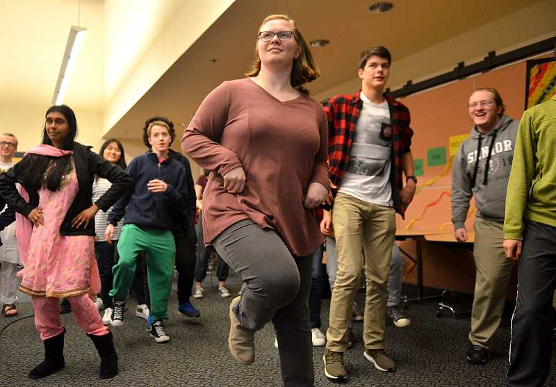 TIDINGS PHOTO: VERN UYETAKE - Junior Caitlin McCabe and others present join in on the dance demonstration.
