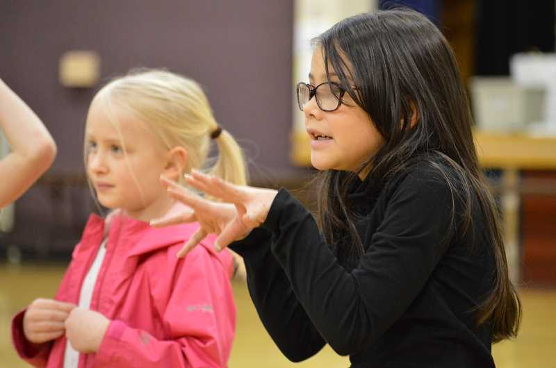 TIDINGS PHOTO: CLARA HOWELL  - First-graders Emma Abel, left and Madison Sound practice their lines.