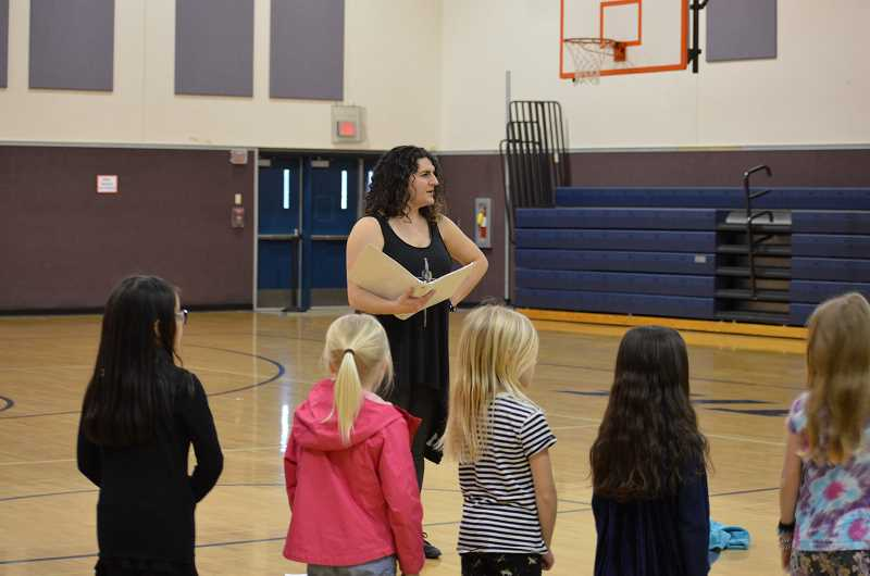 TIDINGS PHOTO: CLARA HOWELL - Director Mandana Khoshnevisan gets smiles and laughs from students during rehearsal.
