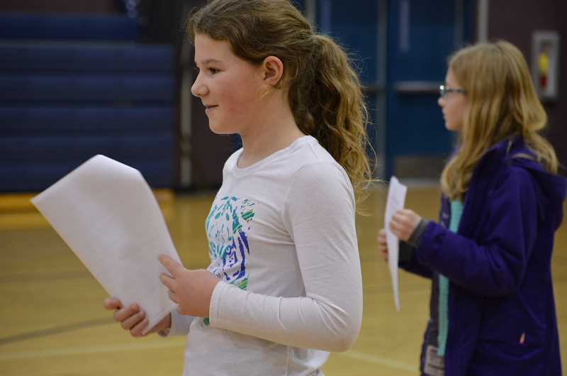 TIDINGS PHOTO: CLARA HOWELL - Izzy Ludemann, 10, left, and Addison Woebke, 10, are attentive during their first practice.