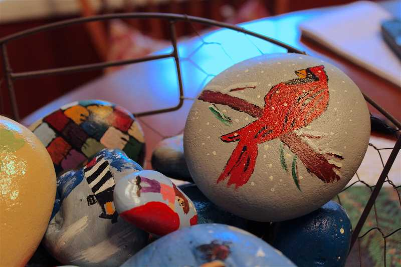 REVIEW PHOTO: SAM STITES - Rich Simons paints about 12 rocks per day to keep up with demand. He uses Pinterest to gain inspiration to try new images of animals, characters and inspirational words.
