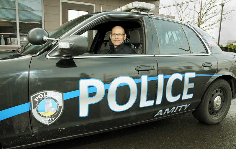 GARY ALLEN - Chris Bolek took over as Amity police chief recently after a long career as an officer in the Newberg-Dundee Police Department.