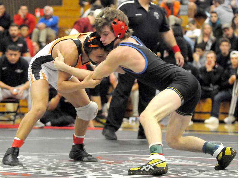 SETH GORDON - Junior Christopher Strange grapples with Culver's Lorenzo Vasquez in the 113-pound title match at the Reser's Tournament of Champions Saturday. Strange rallied late, but could not overcome an 8-1 deficit, eventually losing 10-8.
