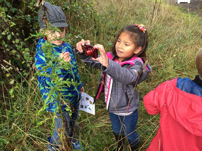 COURTESY PHOTO - Forest Grove Community School students explore the outdoors on field trips and other excursions.