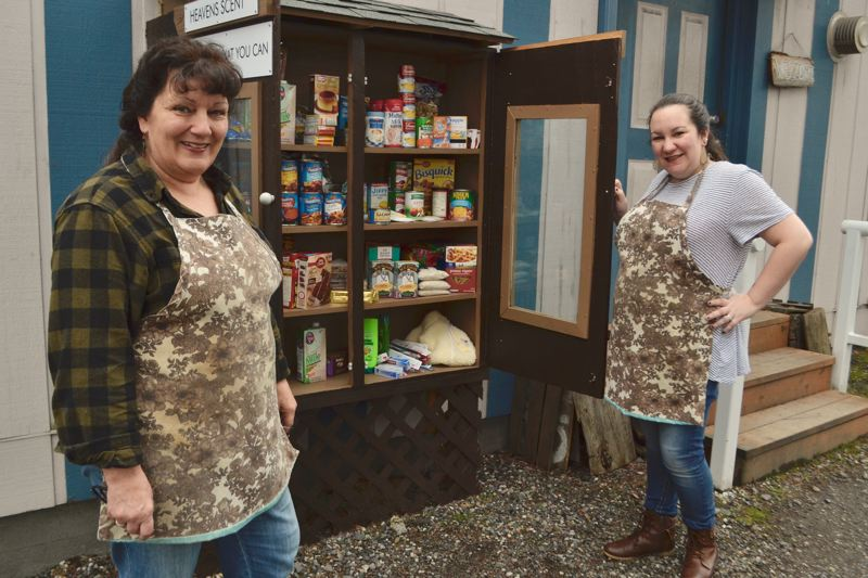 POST PHOTO: BRITTANY ALLEN - Heaven Scent Baked Goods Owner Kelly Shewbert and her daughter Brittany O'Brien, with help from community members, created a food pantry to benefit families in need.