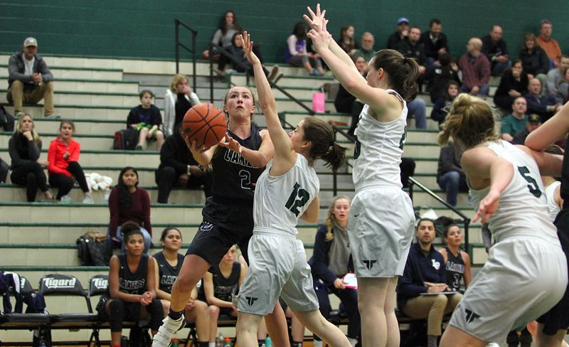 REVIEW PHOTO: MILES VANCE - Lake Oswego freshman Emma Jeanson goes up for a shot during her team's 73-37 loss at Tigard High School on Tuesday.