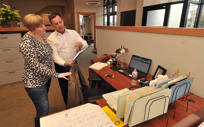 Harnish Properties agents Jennifer Fish and Errol Bradley review property files in the companys new office on B Avenue in Lake Oswego.