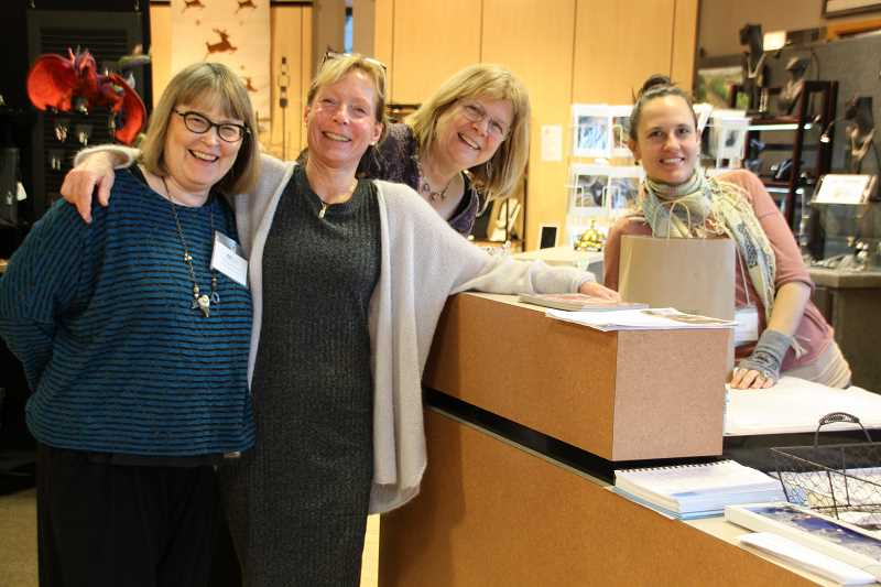 SUBMITTED PHOTO  - Rain Spark Gallery artists Margaret Joyce (from left), Jani Hoberg, Gerry Foote and Shelly Dulcia-Laiche prepare to reopen the gallery in Lake View Village. Rain Spark Gallery will be open at least through February.