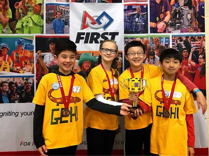 SUBMITTED PHOTO - Lake Oswego Junior High students Nick Villarino (from left), Sophia Kamsha, Gregory Park and Aaron Tsai won the first-place Core Value Inspiration Award at the 16th-annual Oregon FIRST Lego League Championship Tournament.