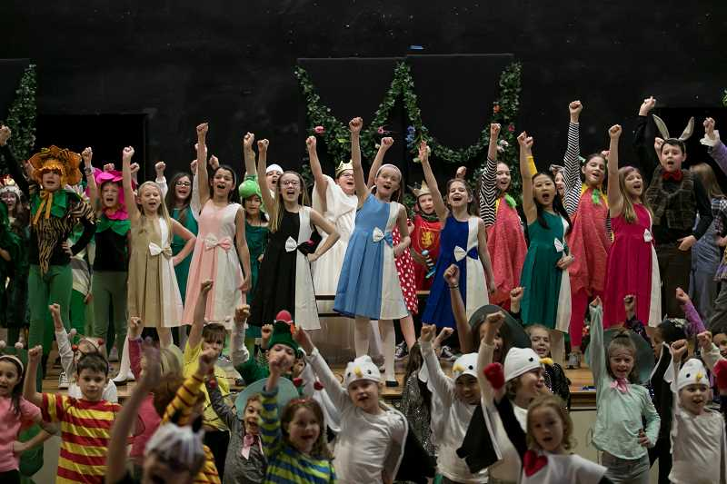 SUBMITTED PHOTO: TOM HAUCK - Lake Grove Elementary School's production of 'Alice (Inside Out) in Wonderland' featured 103 cast members, many of whom gathered triumphantly on stage last week for this musical number.
