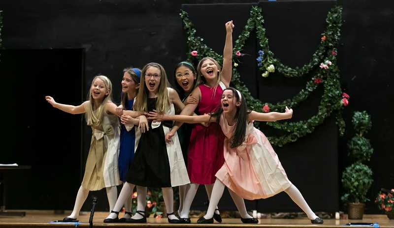 SUBMITTED PHOTO: TOM HAUCK - The six emotions of Alice — Disgust, Pride, Joy, Fear, Sadness and Anger — perform together during Lake Grove Elementary School's production of 'Alice (Inside Out) In Wonderland.'