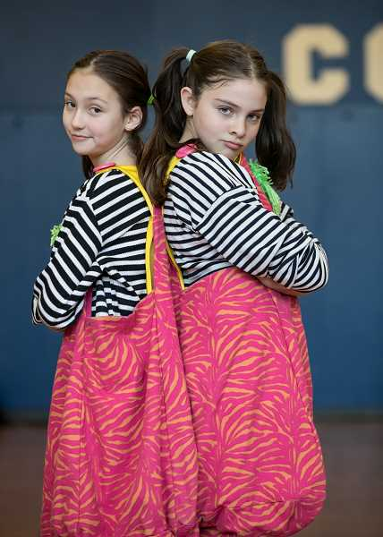 SUBMITTED PHOTO: TOM HAUCK - Lake Grove fifth-graders Madeline Heder and Audrey Hauck starred as Tweedle Dee and Tweedle Dum in 'Alice (Inside Out) in Wonderland.'