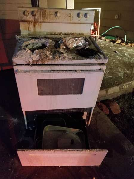 SUBMITTED PHOTO - A stove was destroyed in a cooking fire in a duplex on Southwest Second Street on Jan. 16.