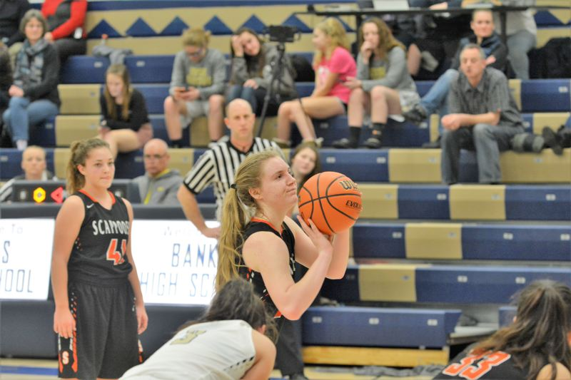 SPOTLIGHT PHOTO: JAKE MCNEAL - Senior post Kaylee Wegner sparked the Indians with 12 points in a 52-26 loss Tuesday in Banks.