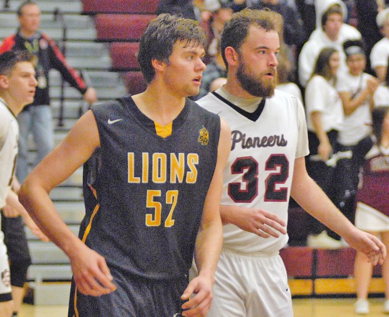 SPOTLIGHT PHOTO: JAKE MCNEAL - Senior forward Jacob Falk (52) dunked the Lions into a 62-58 lead with 46.5 seconds left in Sandy.