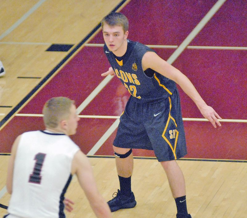 PAMPLIN MEDIA PHOTO: MATT RAWLINGS - Senior guard Drake Dow (22) gave his Lions their first lead over Sandy, 45-44, with a layup at 7:05 left in regulation.