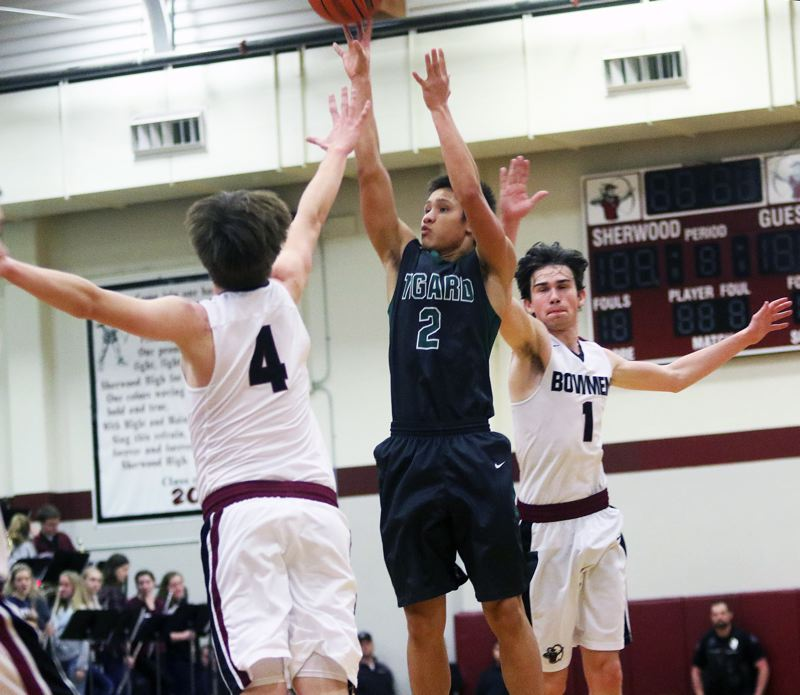 TIMES PHOTO: DAN BROOD - Tigard's Jazz Ross and the Tigers visit Lake Oswego at 7 p.m. Friday with the Three Rivers League lead on the line.