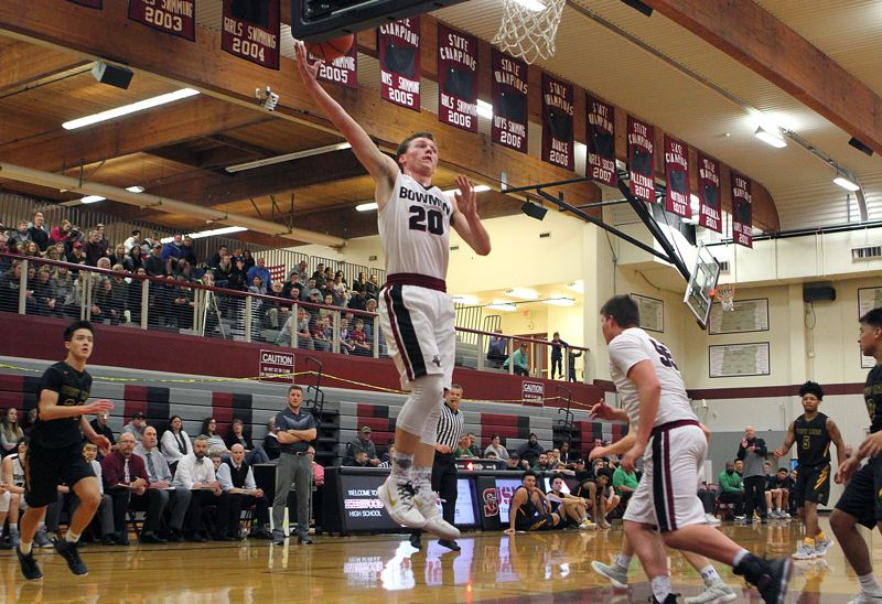 PAMPLIN MEDIA GROUP: MILES VANCE - Sherwood senior Owen Grubbe goes up to the basket during the Bowmen's game with West Linn on Friday.