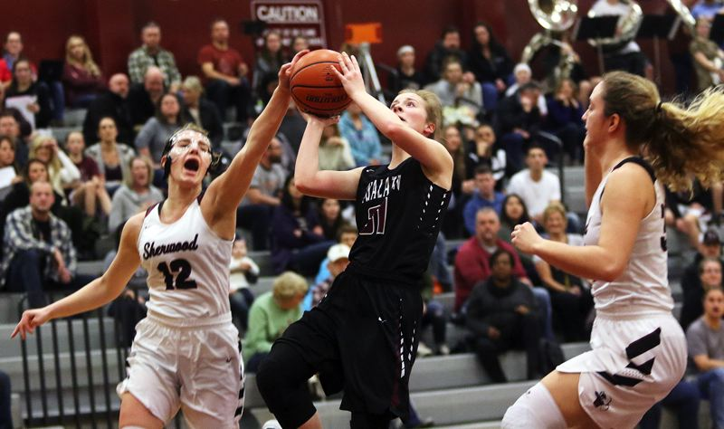DAN BROOD - Tualatin junior Anna Withers looks to take a shot in Tuesday's game at Sherwood.