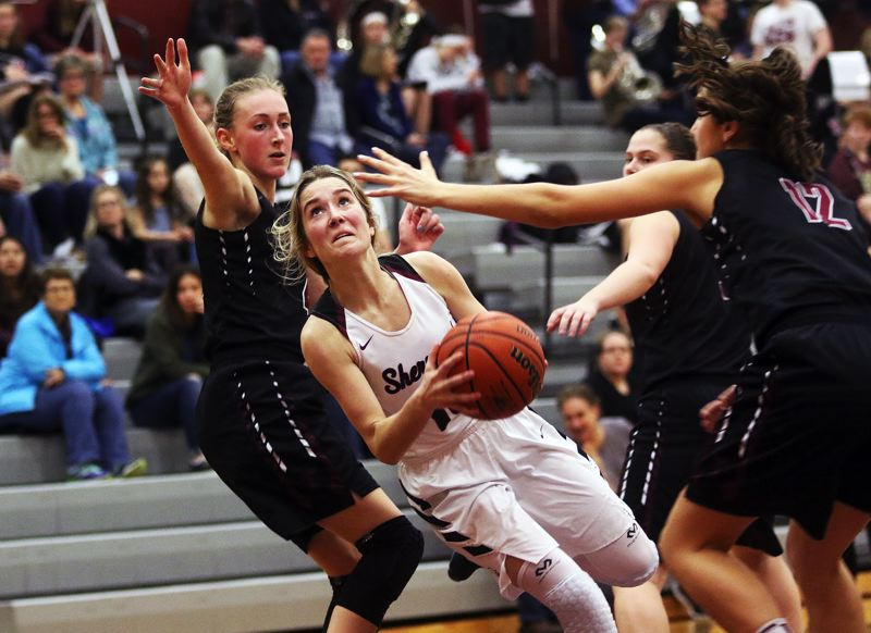 DAN BROOD - Sherwood senior Lauren Scarvie looks to get to the basket during Tuesday's game with Sherwood.