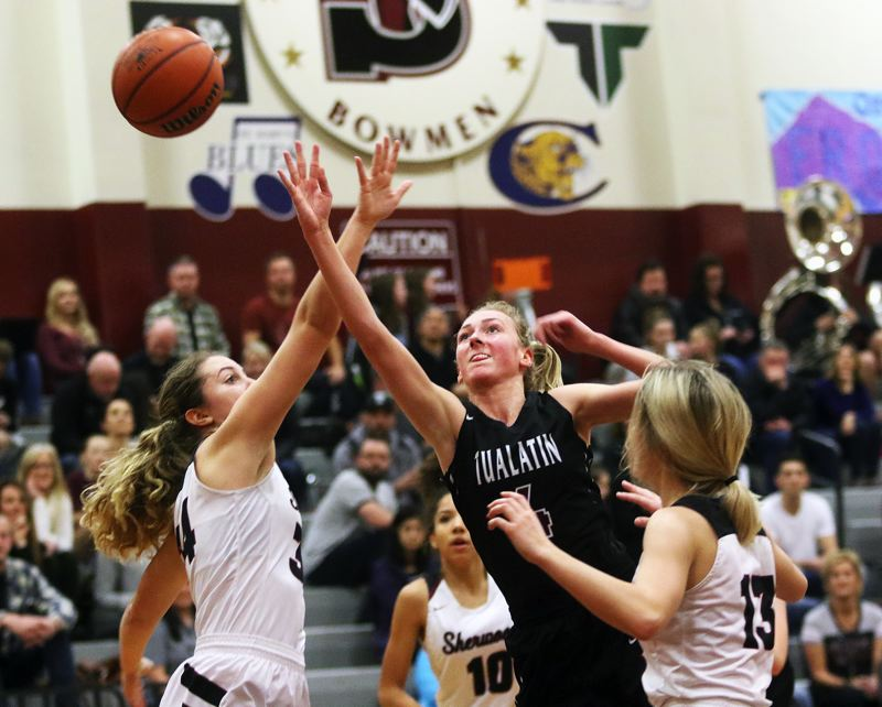 DAN BROOD - Tualatin junior Natali Denning puts up a shot during Tuesday's game at Sherwood.
