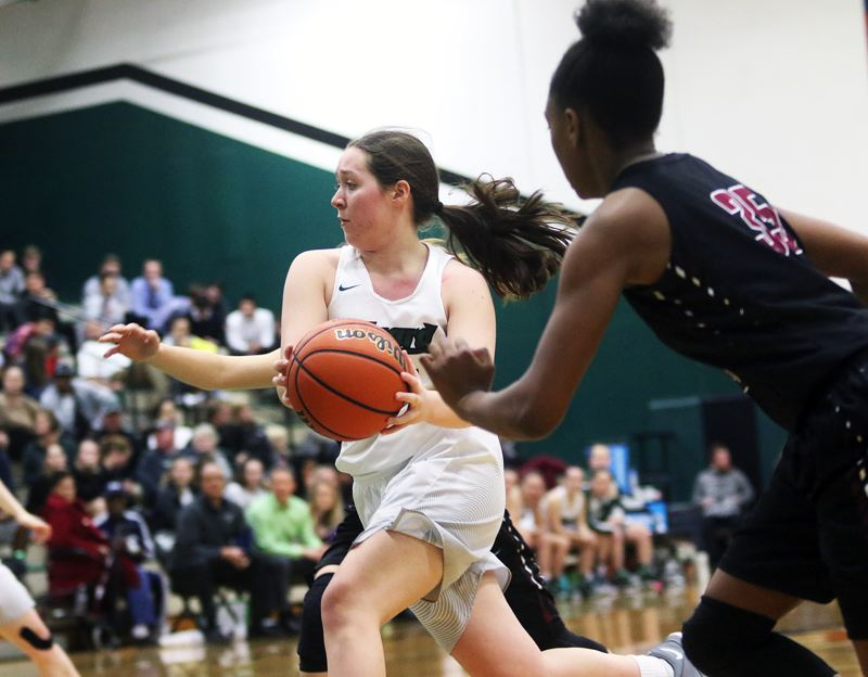 DAN BROOD - Tigard senior Paige LaFountain looks to drive to the basket during the win over Tualatin.