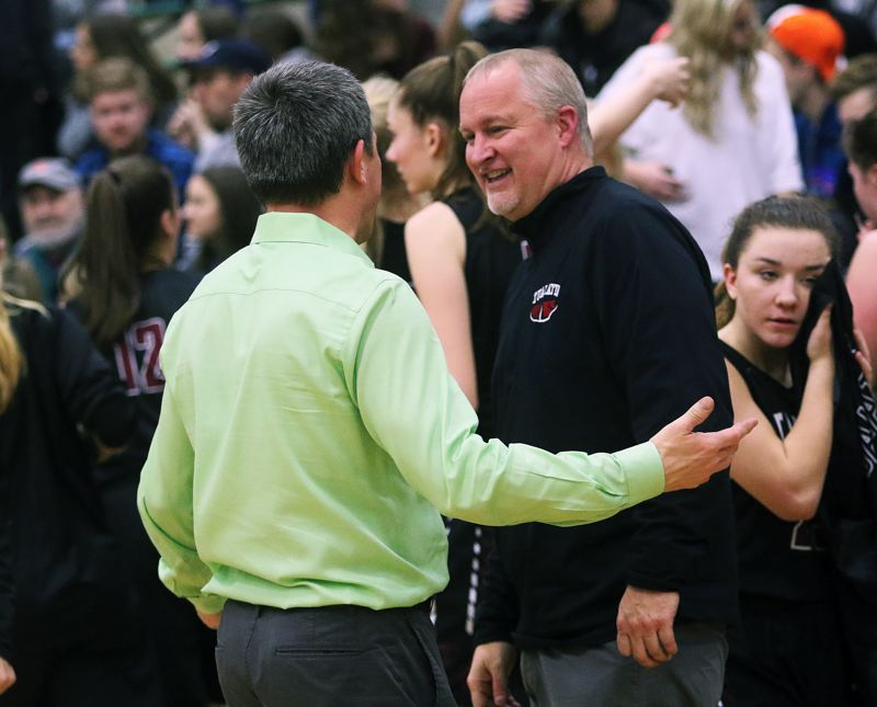 DAN BROOD - Tigard coach Steve Naylor (left) and Tualatin coach Jay Ego talk following their teams' game.