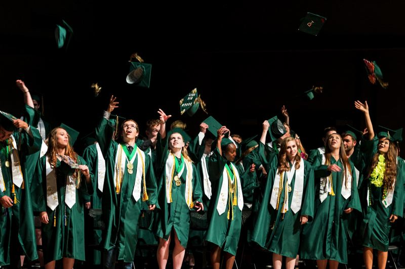 FILE PHOTO: CHRISTOPHER OERTELL - Graduates of Gaston Junior/Senior High School throw their caps into the air in 2017.