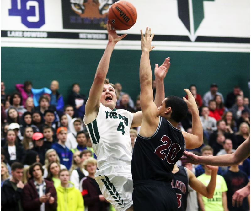 DAN BROOD - Tigard junior Stevie Schlabach takes a jump shot during the win over Tualatin.