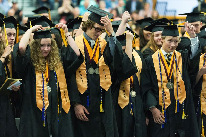 FILE PHOTO: CHRISTOPHER OERTELL - Graduates turn their tassels over at Forest Grove High School's 2017 graduation ceremony.