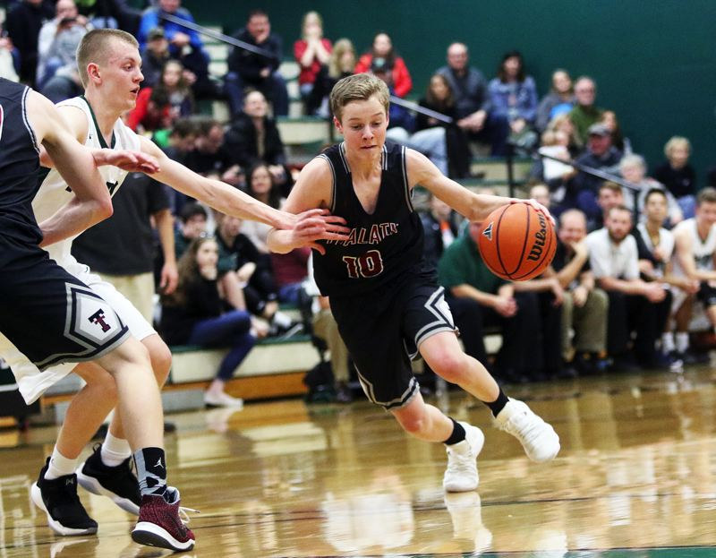 DAN BROOD - Tualatin junior Derek Leneve drives with the ball during the game at Tigard.