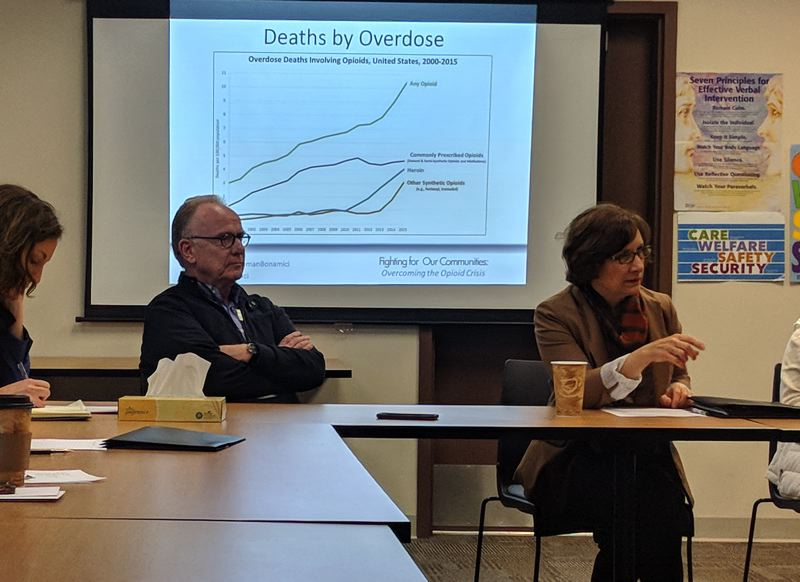 SPOTLIGHT PHOTO: COURTNEY VAUGHN - Roland Migchielsen, executive director of Columbia Community Mental Health, and U.S. Rep. Suzanne Bonamici discuss opioid addiction with a group of counselors and patients during a recent visit to the mental health facility.