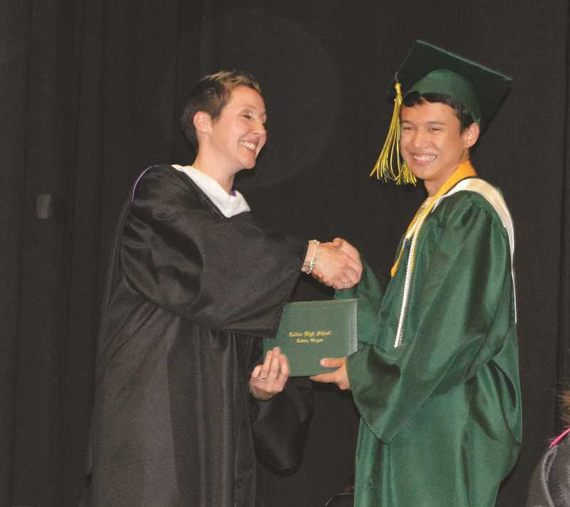 PIONEER FILE PHOTO - At Colton's 2017 graduation, Principal Tori Hazelton awards Aaron Wimsatt his honors diploma.