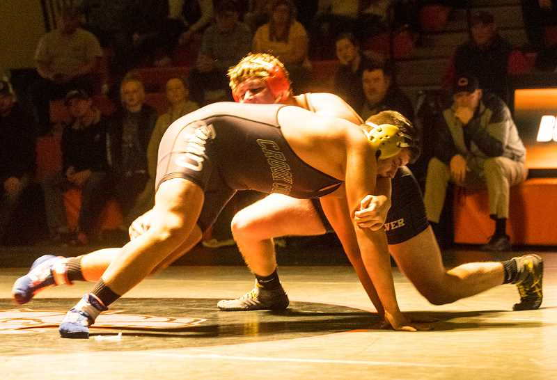LON AUSTIN/CENTRAL OREGONIAN - Mario Hansen, left, and Cole Little battle at 220 pounds during the Cowdog Classic. Hansen scored three points in the second round, then held on to take a tight 3-2 victory over Little. The win helped propel the Cowboys to a 41-28 win over the Bulldogs.