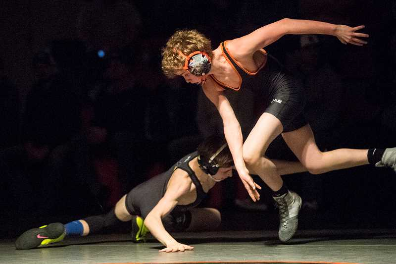 LON AUSTIN/CENTRAL OREGONIAN - Crook County's Steven Ware, left, trips Culver's Brody Piercy early in their 106-pound match. Ware won by fall early in the second period.