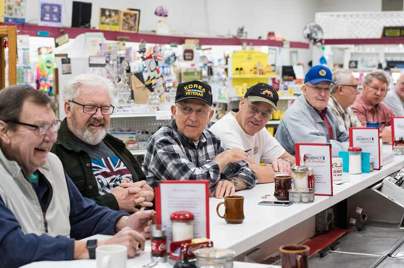 STAFF PHOTO: CHRISTOPHER OERTELL - The 10 a.m. coffee crew chats at the Hillsboro Pharmacy and Fountain, where they have been meeting for breakfast for years.