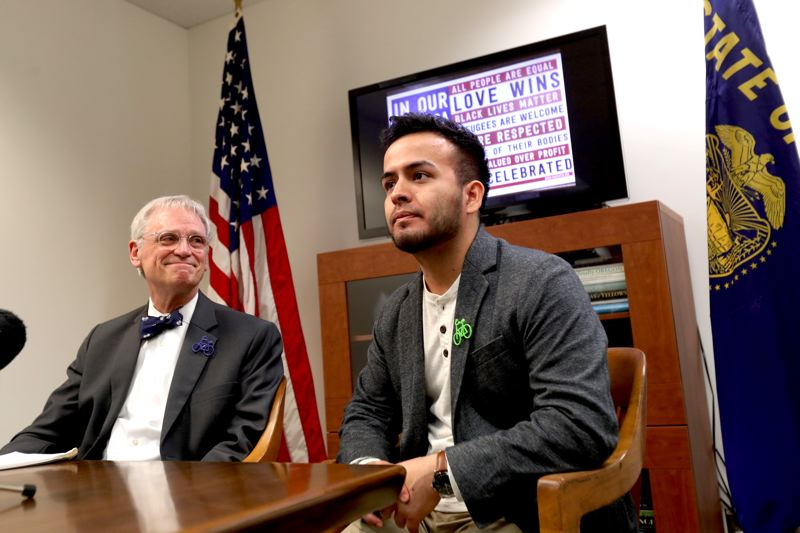 JAIME VALDEZ/PORTLAND TRIBUNE - U.S. Rep. Earl Blumenauer, D-Oregon, and DACA recipient Aldo Solano of Portland speak to reporters at the congressman's office in Northeast Portland Jan. 26, 2018. Solano will represent Blumenauer at President Donald Trump's State of the Union address.