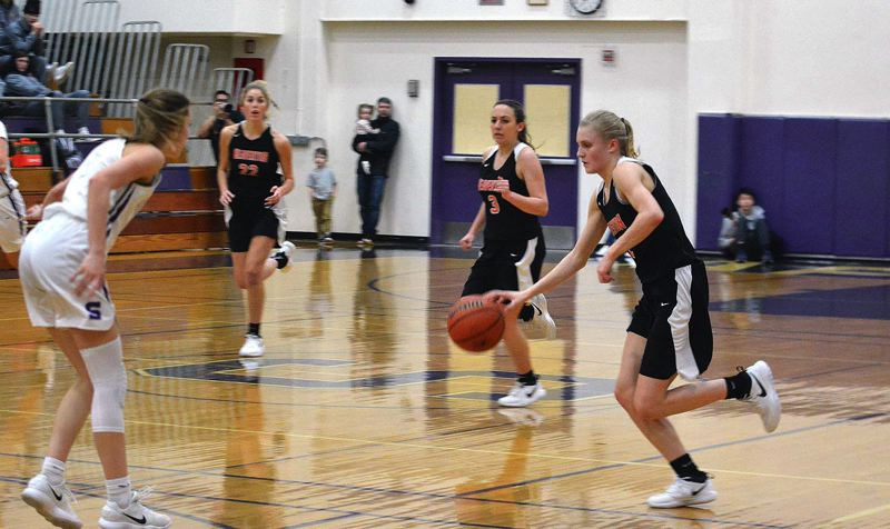 TIMES PHOTO: MATT SINGLEDECKER - Beaverton sophomore point guard Mary Kay Naro brings the ball up the floor against Sunset.