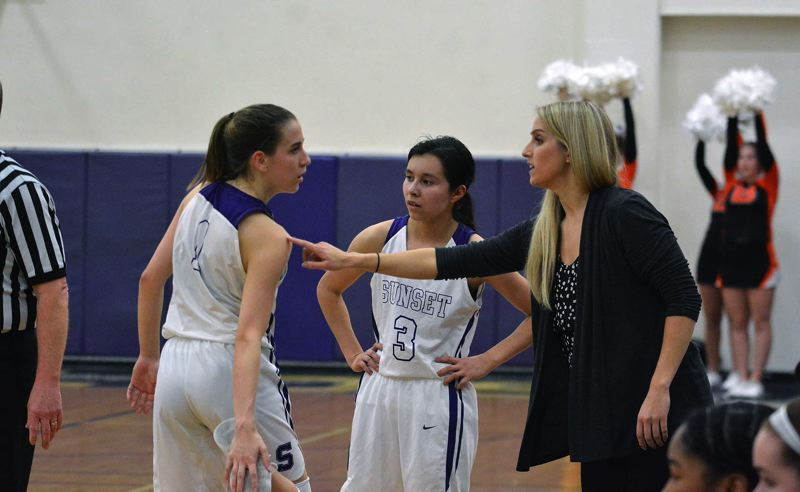 TIMES PHOTO: MATT SINGLEDECKER - Sunset head coach Sarah Griffin talks things over with senior Delaney Ragan and junior Vanessa Lopez.